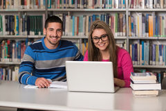Young Students Using Their Laptop In A Library Royalty Free Stock Photos