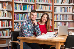 Young Students Using Their Laptop In A Library Stock Photo