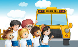 Young students waiting for the schoolbus Stock Photo