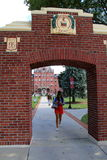 Young students walking through arched columns in between classes,Dean College,Franklin,Mass,2014 Stock Image