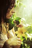 Young stunning beauty with flower Stock Photos