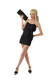 Young stunning blonde lady in black little dress. Posing on white background in full lenght Stock Photography