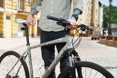 Young styled man is cycling in city Royalty Free Stock Photo