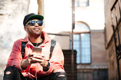 Young stylish afro american man in cap and leather jacket Stock Images