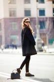 Young stylish beautiful woman walking on city street , europe vacation,Autumn trend,sunglasses, smiling, luxury, red lips, fashion Royalty Free Stock Image