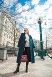 Young stylish beautiful woman walking street. royalty free stock photos