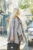 Young stylish woman walking on the city street Royalty Free Stock Image