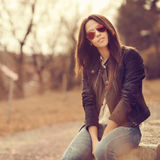 Young stylish brunette woman posing outdoor Stock Photo