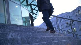 Young Stylish Businessman walking up the stairs towards office building stock video