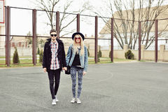 Young stylish couple outdoor fashion portrait Royalty Free Stock Photo