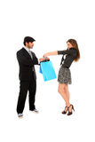 Young stylish couple with shopping bags Stock Images