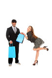 Young stylish couple with shopping bags Royalty Free Stock Image