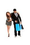 Young stylish couple with shopping bags Stock Image