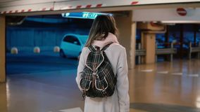 Young stylish female traveler walking across the airport terminal hall with suitcase. Woman come on vacation. Young stylish female traveler walking across the stock video footage