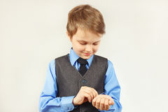 Young stylish gentleman fastened buttons on sleeve his blue shirt Stock Image