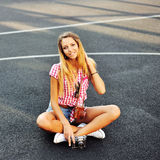 Young stylish girl in casual clothes posing outdoor Royalty Free Stock Images