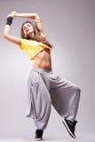Young stylish girl dancing royalty free stock image