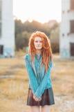 Young stylish girl with dreadlocks. Outdoors Stock Image