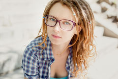 Young stylish girl with dreadlocks outdoors. Royalty Free Stock Photo