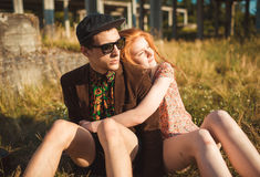 Young stylish girl and guy with a vintage suitcase outdoors Stock Images