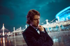 Young stylish guy on the background of night city, city lights stock images