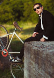Young stylish guy with bicycle outdoors Royalty Free Stock Images