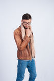Young stylish guy in the brown jacket Stock Photography