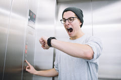 Young stylish guy standing in elevator Royalty Free Stock Photo