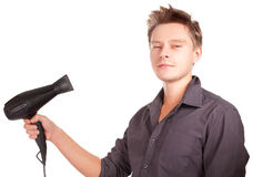 Young  stylish haircutter holding iron and have fun. Royalty Free Stock Image