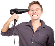 Young  stylish haircutter holding iron and have fun. Royalty Free Stock Photography