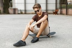 Young stylish handsome man in fashionable sunglasses resting. On a summer vacation Royalty Free Stock Image