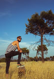 Young stylish handsome man in the savannah Royalty Free Stock Images