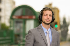 Young stylish handsome man wearing headphones in Stock Photos
