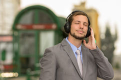 Young stylish handsome man wearing headphones in Stock Photography