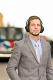 Young stylish handsome man wearing headphones in Stock Image