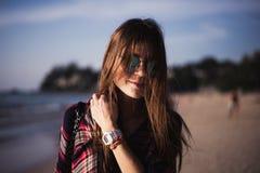 Young stylish happy hipster woman traveling around the world wearing aviator sunglasses, denim shirt, tropical island Stock Photo