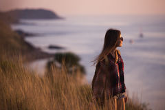 Young stylish hipster girl enjoy sunset on viewpoint. Travel woman with backpack Stock Images
