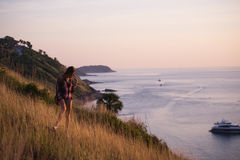 Young stylish hipster girl enjoy sunset on viewpoint. Travel woman with backpack Royalty Free Stock Photography