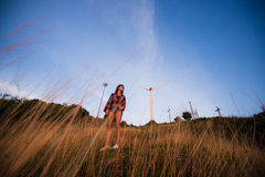 Young stylish hipster girl enjoy sunset on viewpoint. Travel woman with backpack Royalty Free Stock Image