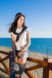 Young stylish hipster girl enjoying good sunny weather and vacation Stock Photos