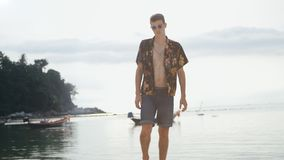 Young stylish man at the background of sea at boats royalty free stock photo