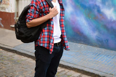 Young stylish man with a bagpack. Stock Photos