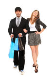 Young stylish man and girl. Young stylish couple going for shopping Royalty Free Stock Photos