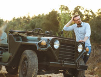 Young stylish man with glasses and bow tie near the old-fashione Royalty Free Stock Photo