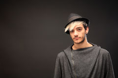 Young stylish man with hat Stock Photography