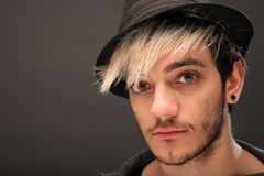 Young stylish man with hat Royalty Free Stock Images