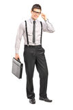 Young stylish man holding a leather briefcase and looking at cam Stock Photography