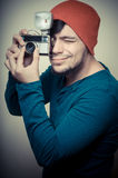 Young stylish man holding old camera Royalty Free Stock Images