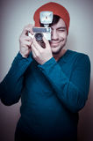 Young stylish man holding old camera Stock Photos