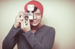 Young stylish man holding old camera Royalty Free Stock Photo